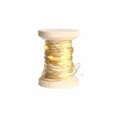 Bobine de fil lumineux doré