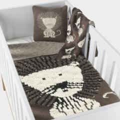 Coussin tricoté Lion